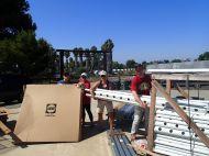 Trish Lovato, Diana Knapp, Jane Jones and David Johnson hauling more rows for organic lettuce to be planted