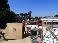 Trish Lovato, Diana Knapp, Jane Jones and David Johnson hauling more rows for organic lettuce to be planted